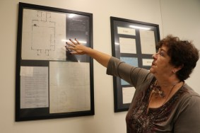 EUT staff member Cathy Severance points to a old hand-drawn floor map now on display at the EUT offices in Augusta.