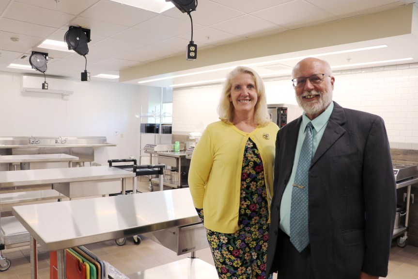 Joanne Allen, Director of Maine DOE Office of School Finance and Operations stands with and Walter Beesely, Director of Child Nutrition at Maine DOE in the new Culinary Classroom.
