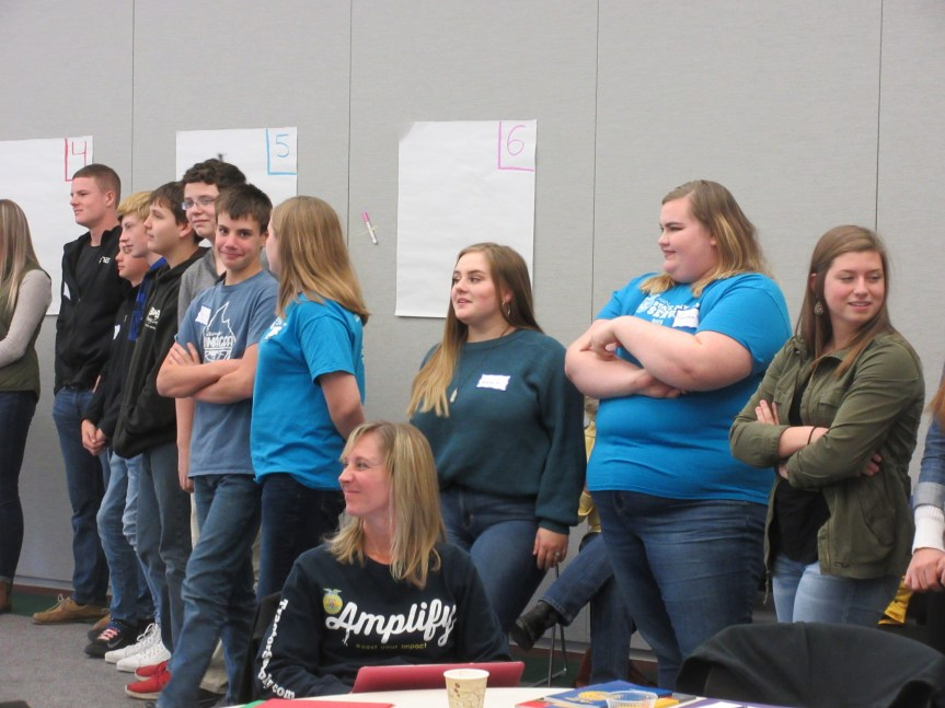 : FFA leaders participate in an activity emphasizing the importance of high quality communication.