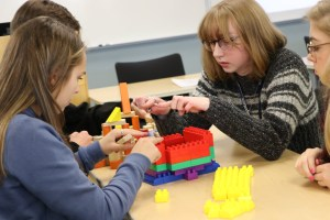 students working with blocks
