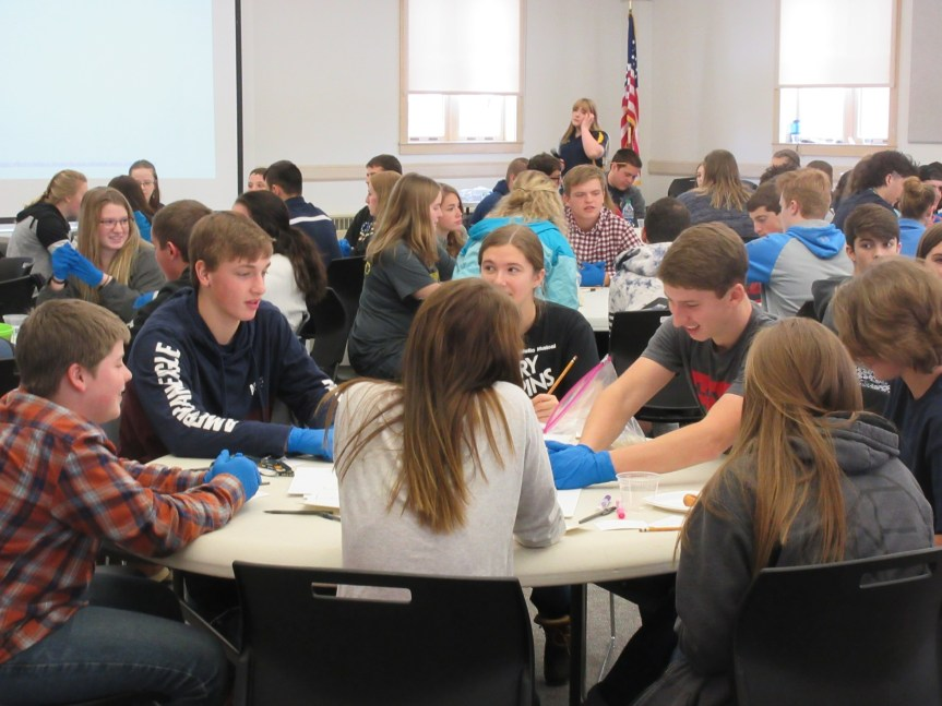 Considering Positive Influence in Leadership (left to right at table in foreground, five students facing camera): Hunter Cunningham, Ashland Middle School - Nick Margeson, Caribou Technology Center – Madelyn Buzza, Presque Isle Regional Career & Technical Center (PIRCTC) - Creed Chasse, Ashland High School – Maggie Currie & Clay Gregg, PIRCTC