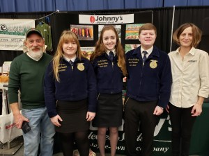 Maine FFA State Officers meet Craig Flood, Research Technician and Amy LeClair, Charitable Giving / Outreach Coordinator, at display for Johnny's Selected Seeds