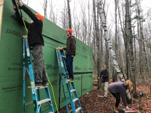 Elias Parker, Jack Mahoney, Mikeal Van Mierlo working on their artist's shed