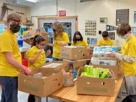 United Technologies Region 4 Bangor Horticulture FFA students sorting homeless shelter items