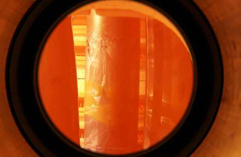 Crystalline tube vase photographed in hot kiln