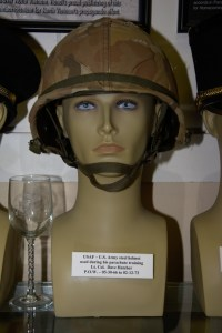 US Air Force/US Army steel helmet used during parachute training by Lt. Col. Dave Hatcher, POW 05-30-1966 to 02-12-1973.