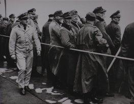 Smiling German prisoners aboard a U.S. Coast Guard ship at Normandy.