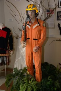 Flight suit for Cdr. Porter Halyburton, USN. He made many flights to Hanoi and Haiphong before he was shot down. It came home with his personal effects as he was wearing Marine fatigues at the time. He was a POW from 10-17-65 to 02-12-73.