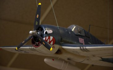 "Close up of the Tiger's mouth on the F6F ""Hellcat"" of VF- 27 flying off the USS Princeton."