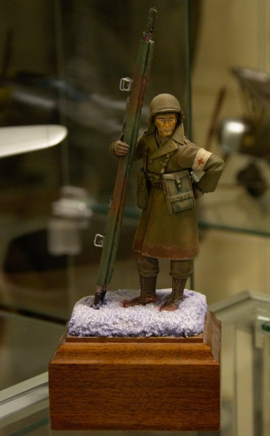 1/32 scale figure of a WWII US Army corpsman in combat at Bastogne during the Battle of the Bulge.
