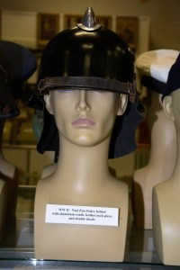 World War II Nazi Fire Police helmet with aluminum comb, leather neck piece and decals