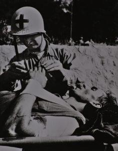 Coast Guard Corpsman giving aid at Normandy.