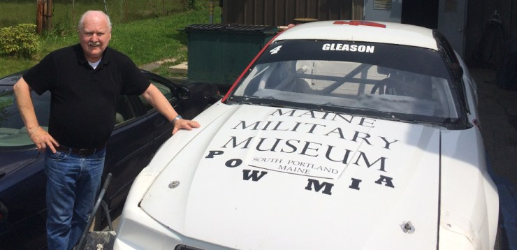 Curator Lee Humiston with the race car.