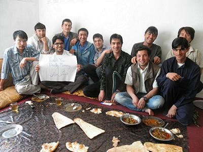 Afghan Peace Volunteers with a sign that thanks Bradley Manning. (Photo: Hakim/supplied)