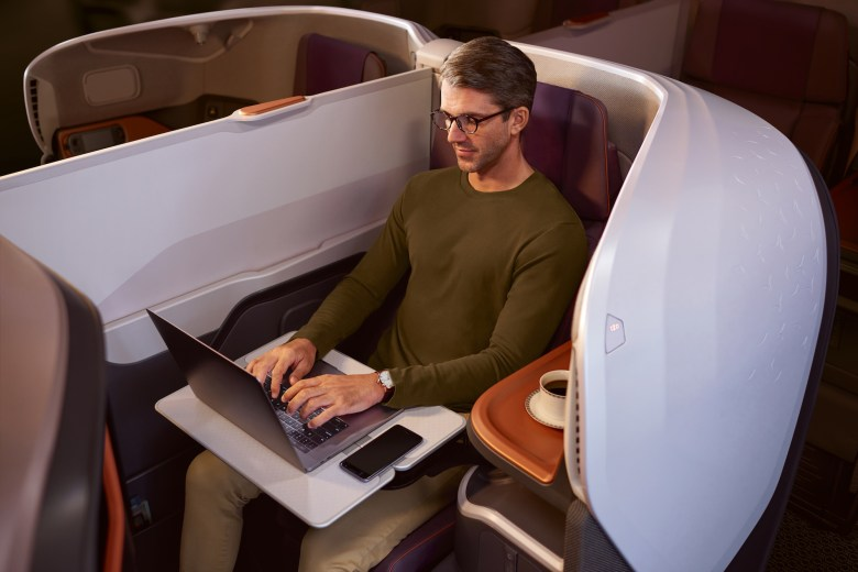 Man on Laptop (Singapore Airlines)