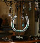 Key chains and horse-shoe ornaments by Chris Stone.