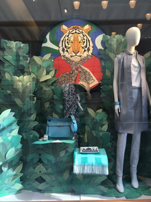 Hermes' Roma store window featuring the new S/S16 green trend..