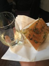 Focaccia bread and white wine at a winery.