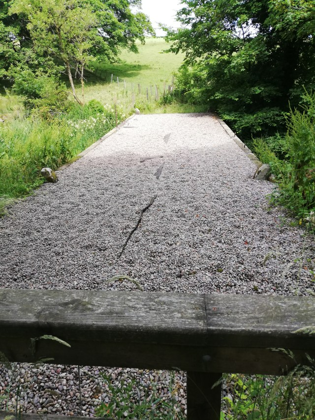 the top of the middle cascade. it looks like a bridge covered in small stones around 6 metres across and 2 metres wide.