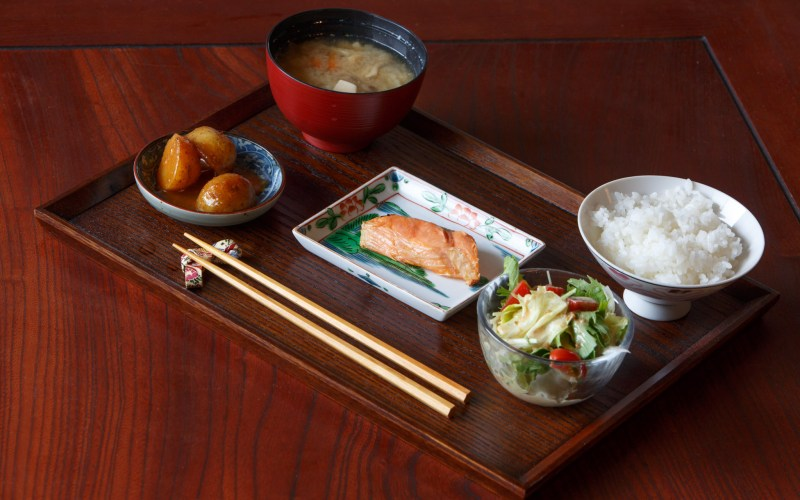 Japanese Breakfast with Salmon, Miso Soup, Salad, Potatoes, and Rice