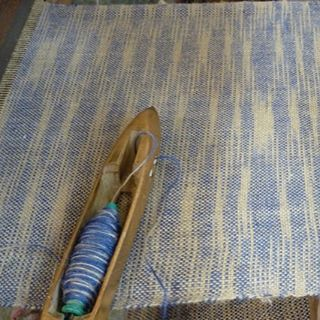 Our blue ikat jute fabric in production