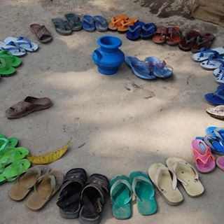 No shoes allowed in class – view outside primary school in rural Bangladesh