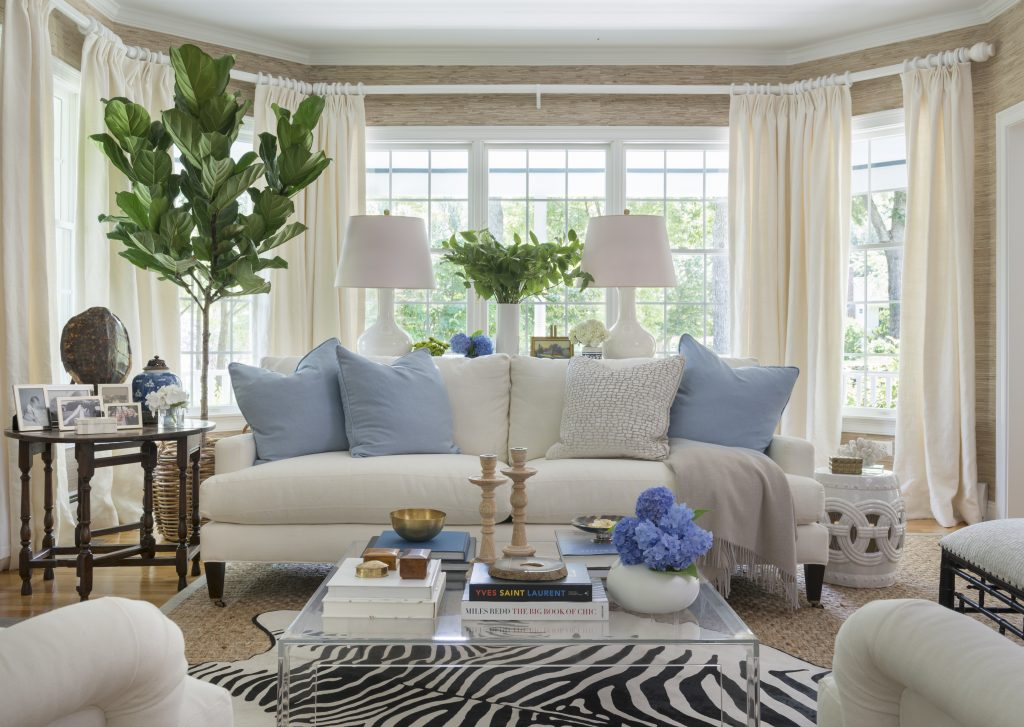animal rugs for living room small designs ideas friday favorites decorating with hides a chic look blue and white