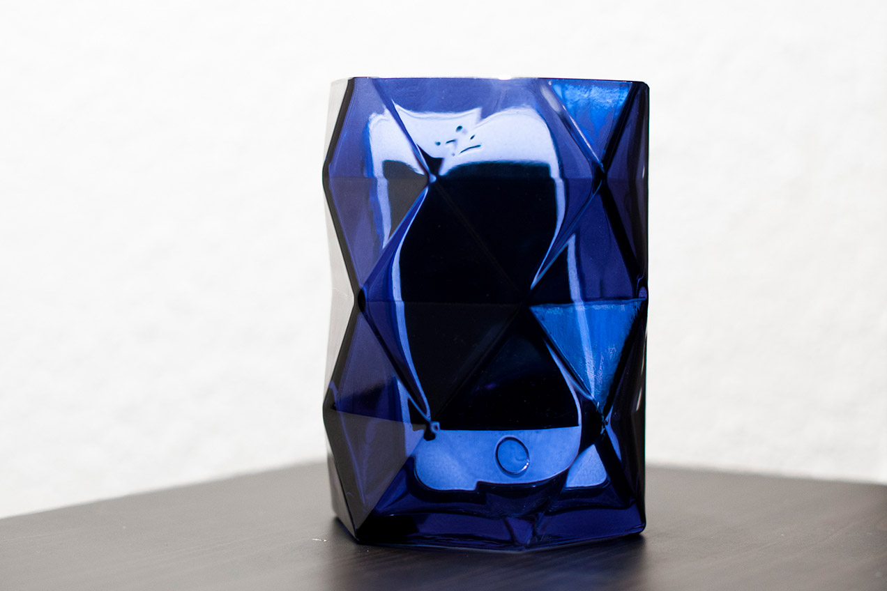 White iPhone 5S inside a blue flower vase