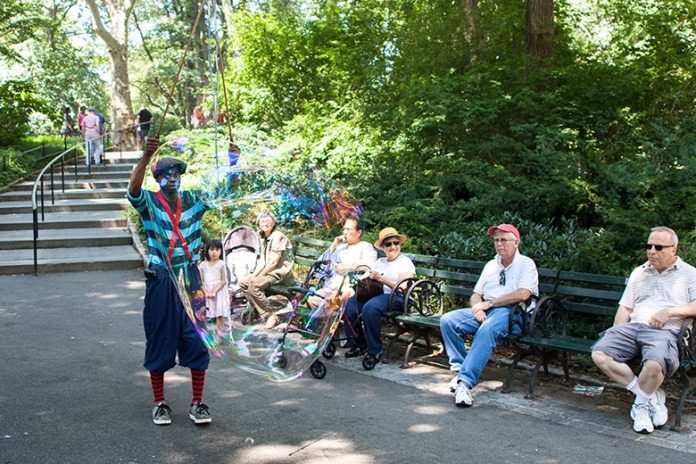 Street performer blowing giant soap bubbles in Central Park