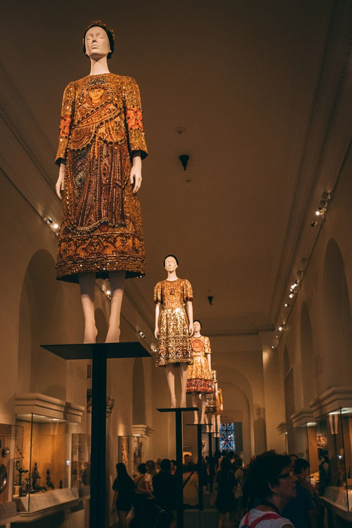 Row of Dolce and Gabbana dresses from the Heavenly bodies exhibit at The Met