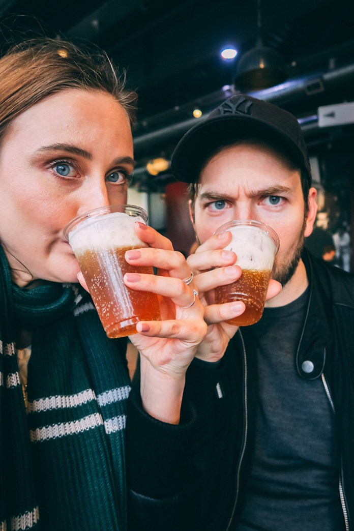 Maja and her boyfriend drinking butterbeer at the Warner Brothers Studio Tour in London.
