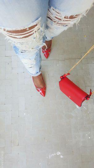 denim and red bag