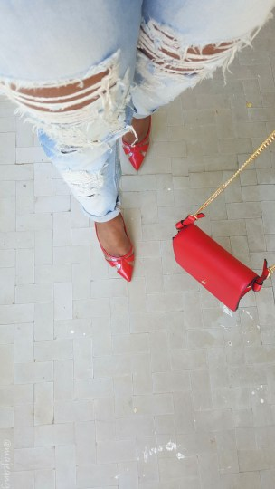 denim and red bag