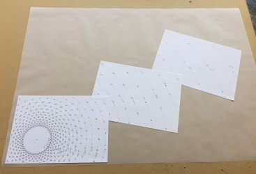 Having precisely worked out the pattern of letters, preparing to transfer it to a large sheet of tracing paper