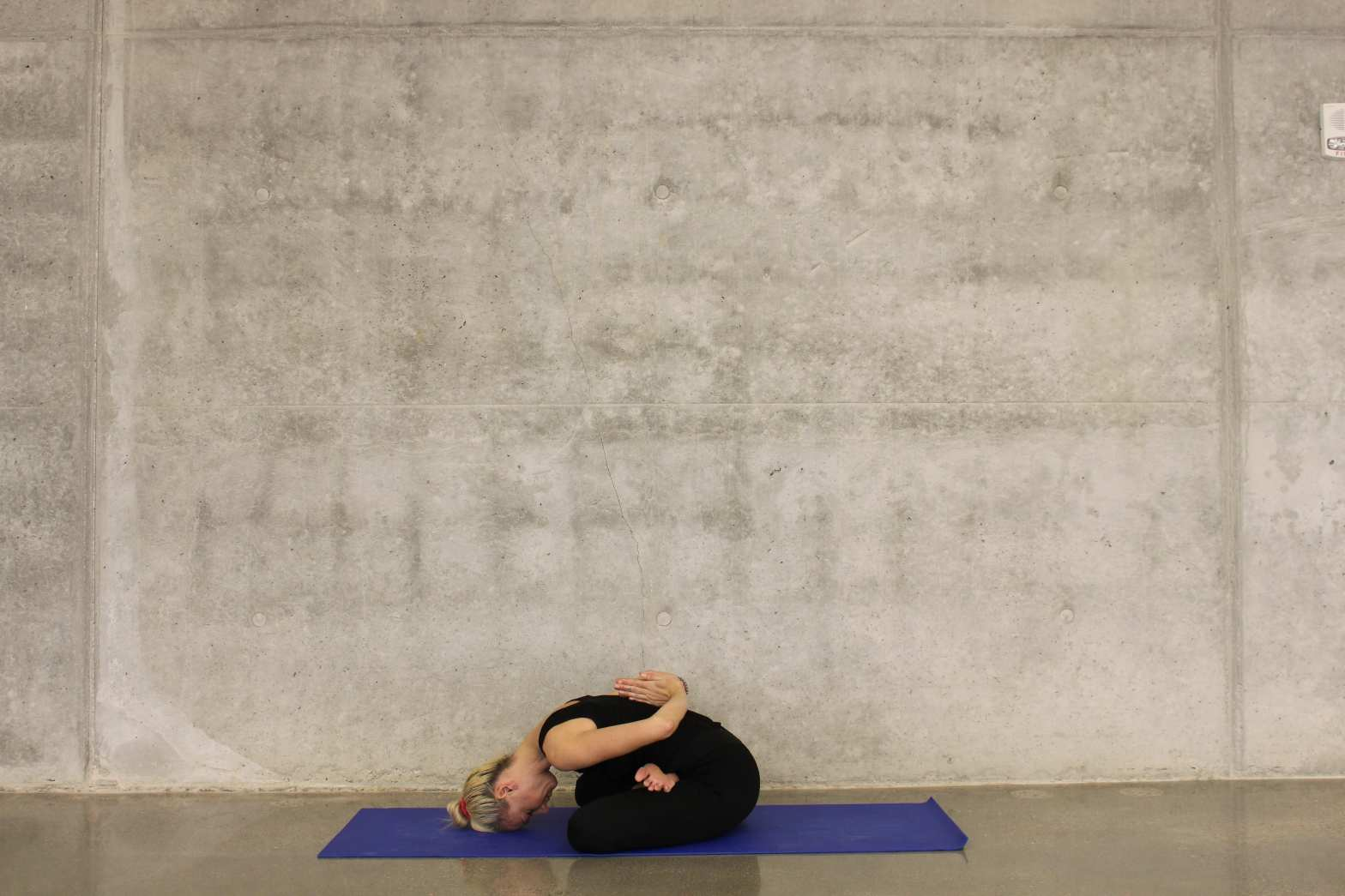 Person doing aa releasing yoga pose