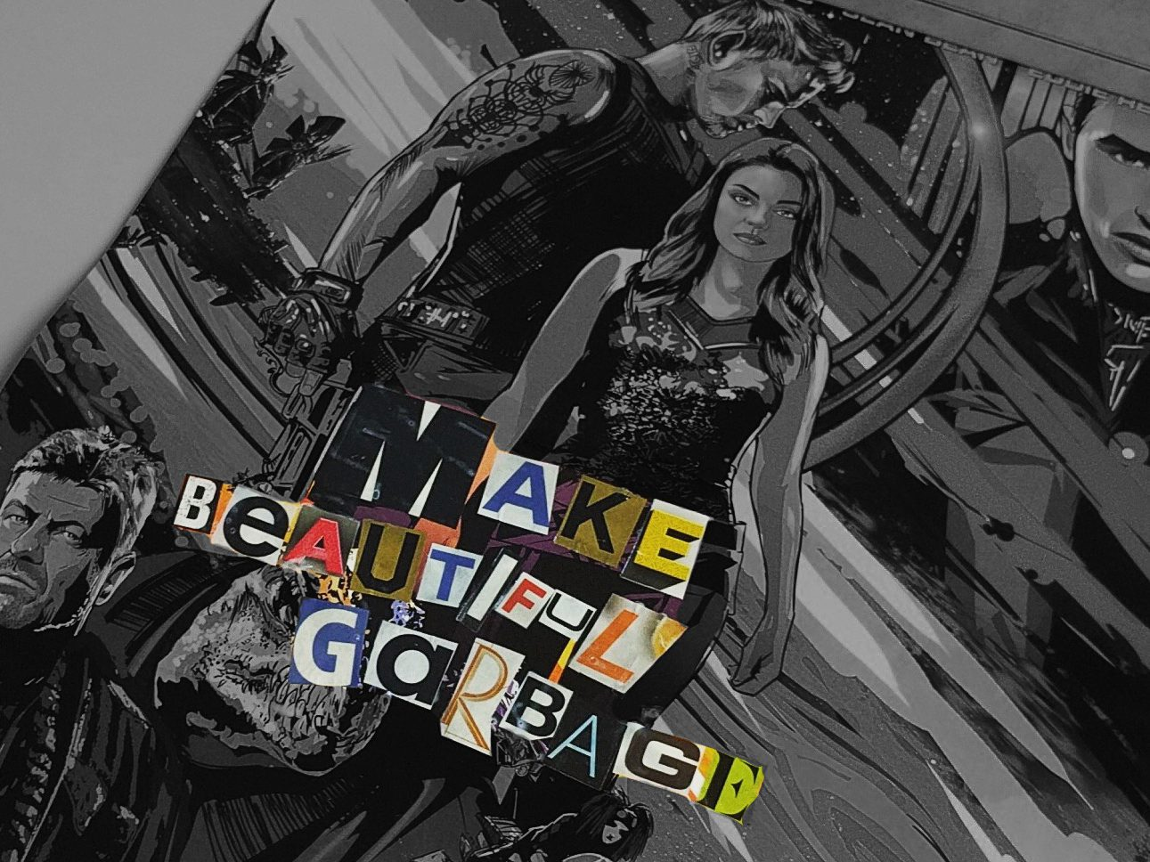 "Decoupaged Jupiter Ascending poster with ""Make Beautiful Garbage"" on it"