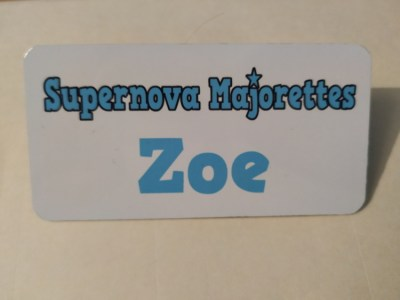 Front of Personalised Metal Badge Zoe Example