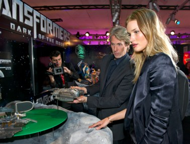 """Transformers: Dark of the Moon,"" star Rosie Huntington-Whiteley and Michael Bay, director, with new ""Transformers Autobot Ark"" space craft toy at Toy Fair in New York"