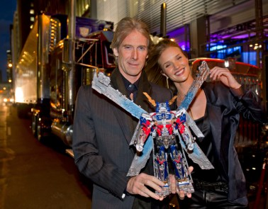 """Transformers: Dark of the Moon,"" star Rosie Huntington-Whiteley and Michael Bay, director, look new ""Transformers Ultimate Optimus Prime"" at Toy Fair in New York"