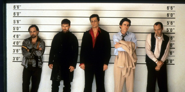 Kevin Pollak, Stephen Baldwin, Benicio Del Toro, Gabriel Byrne and Kevin Spacey line up in a scene from the film 'The Usual Suspects', 1995. (Photo by Gramercy Pictures/Getty Images)
