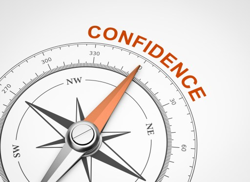 Compass pointing toward the word confidence.