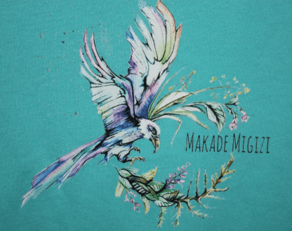 close up of eagle shirt in teal