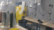 Image shows a lab with lamination equipments used to create prosthetic sockets