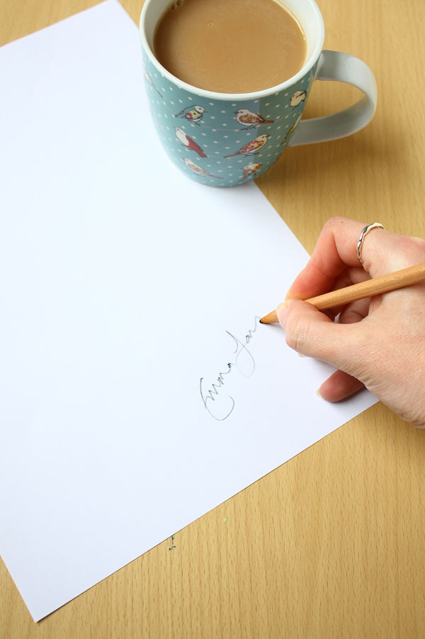 Takea piece of paper and a pencil. Sign your name on the page. Anywhere on will do.