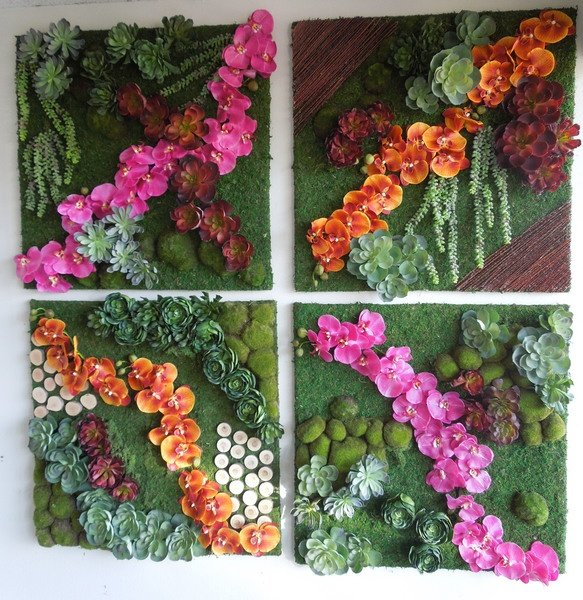 A small grouping of wall pieces including a mix of preserved and faux mosses, artificial Escheverias and Aconitum succulents and silk phaleanopsis orchids.