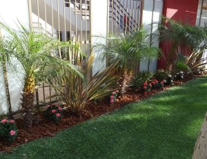 Los Angeles upscale apartment - replaced existing live flowers in planter beds with UV mixed colorful flowers