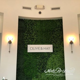 faux green-walls with lighted signage