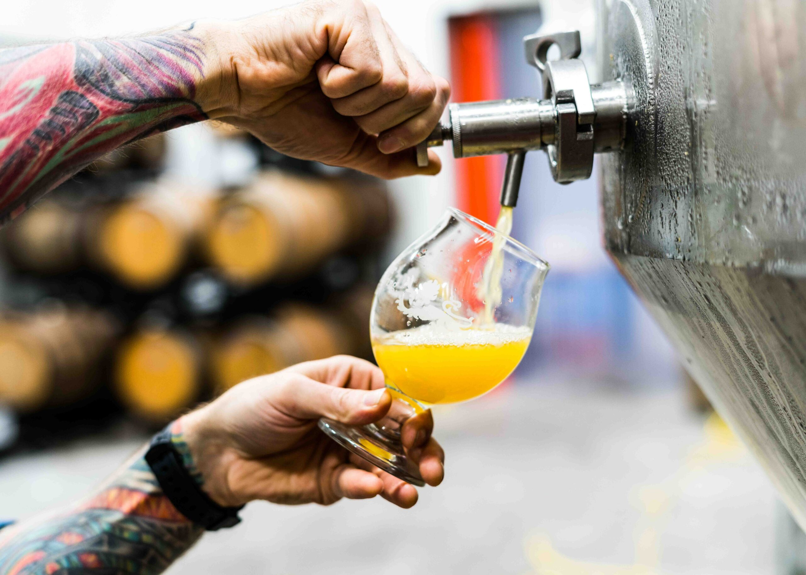 neipa being poured from tap