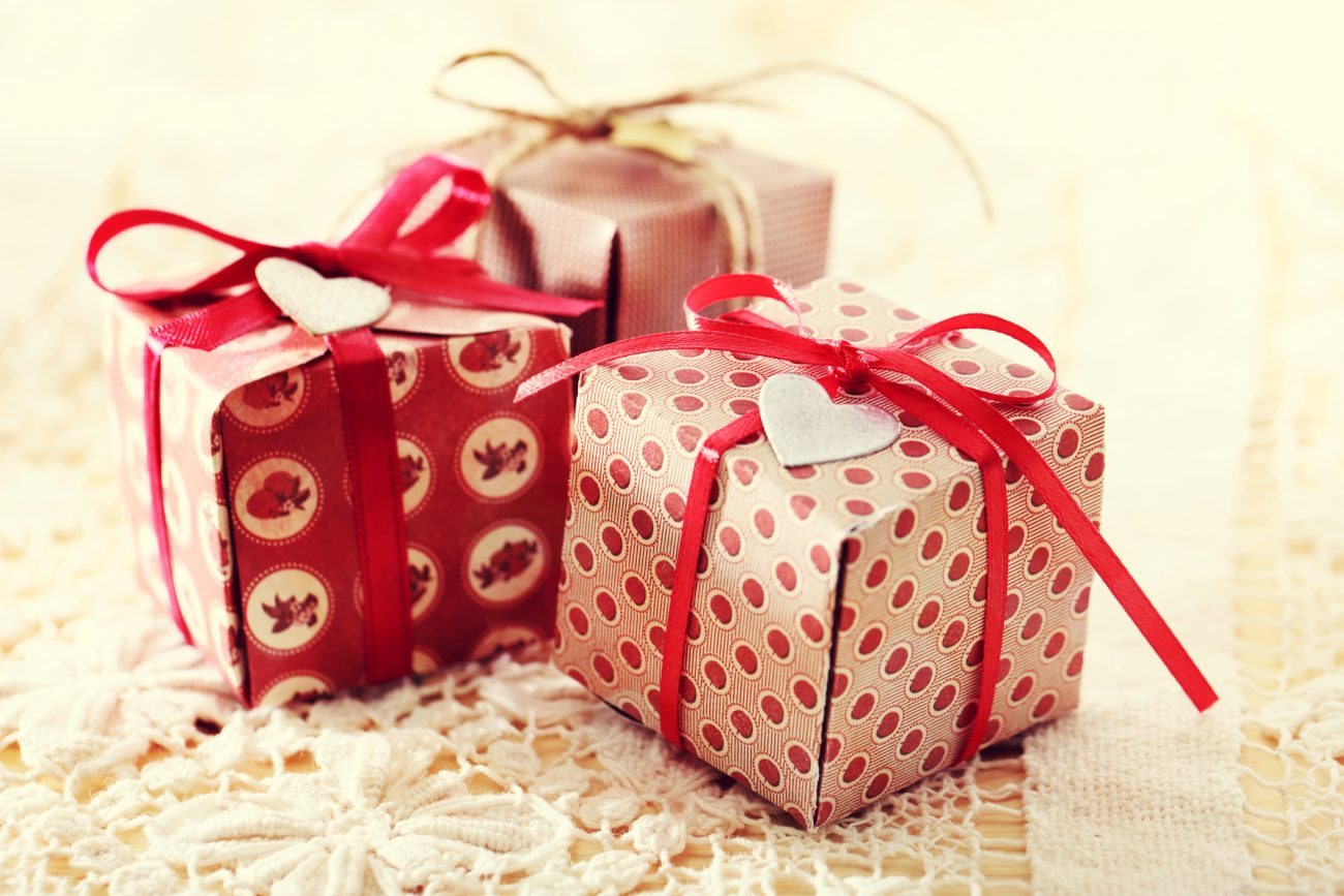 Add embellishments to create a cute finishing touch on DIY gift boxes