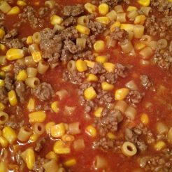 Add in corn to mixture.